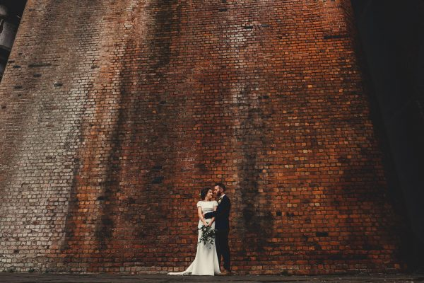 castlefield rooms wedding photographer, castlefield rooms wedding photography, manchester wedding photographer, manchester wedding photography, manchester city centre wedding, ayesha photography, creative manchester wedding photographer, destination wedding photographer, ibiza wedding photographer, ibiza wedding photography, italy wedding photographer, mallorca wedding photographer, bride and groom stand near brick wall
