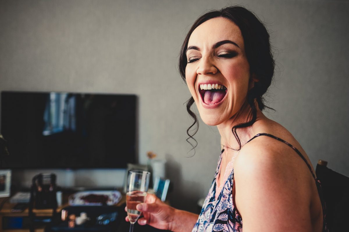 chorley wedding photographer, chorley wedding photography, manchester wedding photographer, manchester wedding photographer, ayesha photography, creative manchester wedding photography, bride laughing holding a glass of champagne
