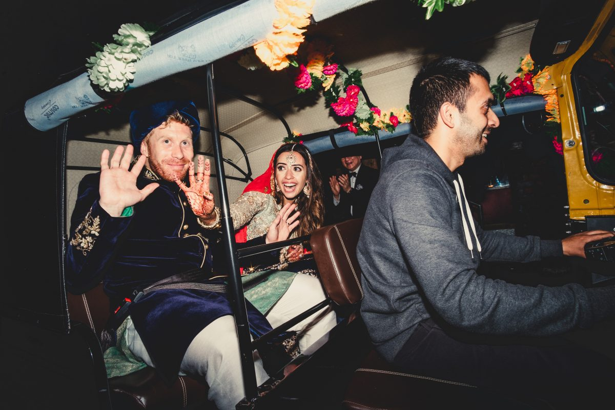 VICTORIA WAREHOUSE ASIAN WEDDING PHOTOGRAPHY, MANCHESTER WEDDING PHOTOGRAPHER, MANCHESTER WEDDING PHOTOGRAPHY, VICTORIA WAREHOUSE WEDDING PHOTOGRAPHER, VICTORIA WAREHOUSE WEDDING, ASIAN WEDDING PHOTOGRAPHER, MANCHESTER ASIAN WEDDING PHOTOGRAPHER, ASIAN FUSION WEDDING PHOTOGRAPHY, AYESHA PHOTOGRAPHY, BRIDE AND GROOM WAVE AT GUESTS AT THE END OF THE NIGHT WHEN THEY LEAVE THEIR WEDDING IN A RICKSHAW