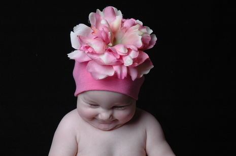 http://s3.amazonaws.com/baby-uploads-production/photos/2518/flower_hat.jpeg