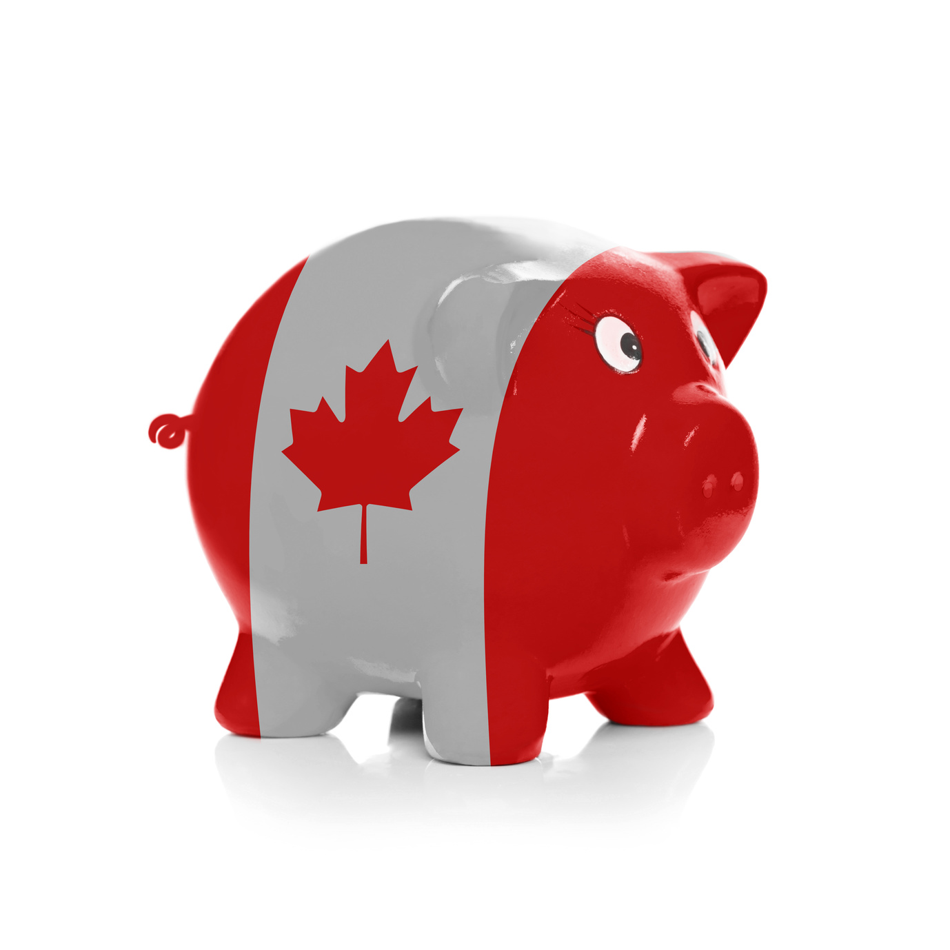 Piggy bank with flag coating over it isolated on white - Canada