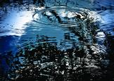 Light_rain_on_blue_pond