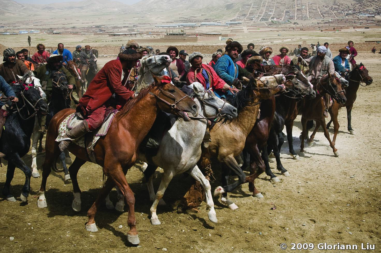 buzkashi in afghanistan Buzkashi is afghanistan's national game and is a brutal struggle between men endeavouring to ride around an unmarked area holding onto a calf's carcass before dumping it in a designated circle.