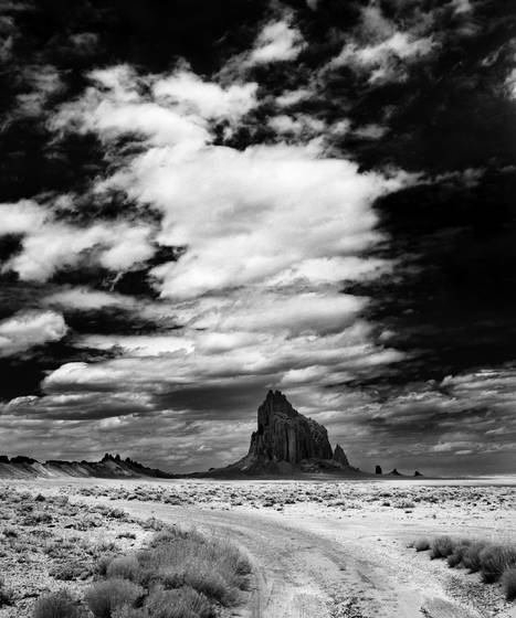 Tall clouds over shiprock