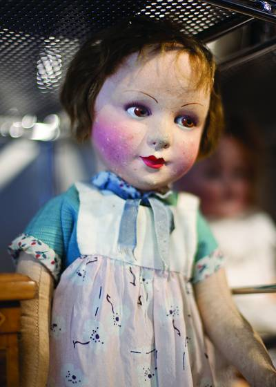 Doll_on_glass_shelf