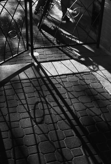 Cyclist_pauses_with_shadows