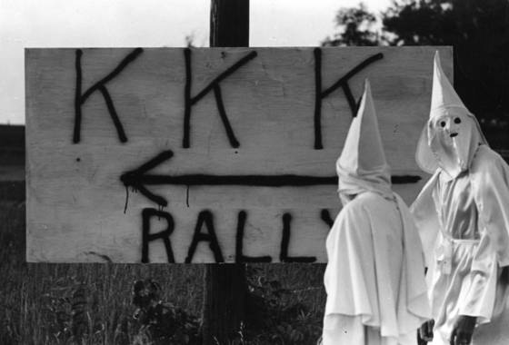 Kkk in front of sign