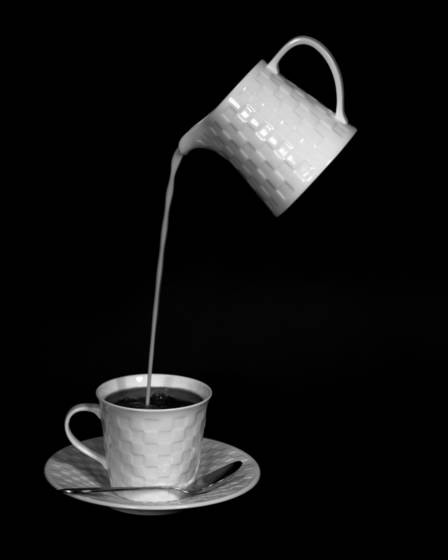 Pouring_milk_into_coffee