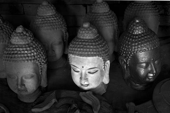 Buddha heads on sculptor s table