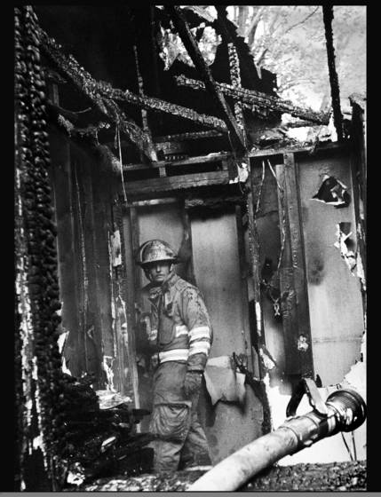 Firefighter in window