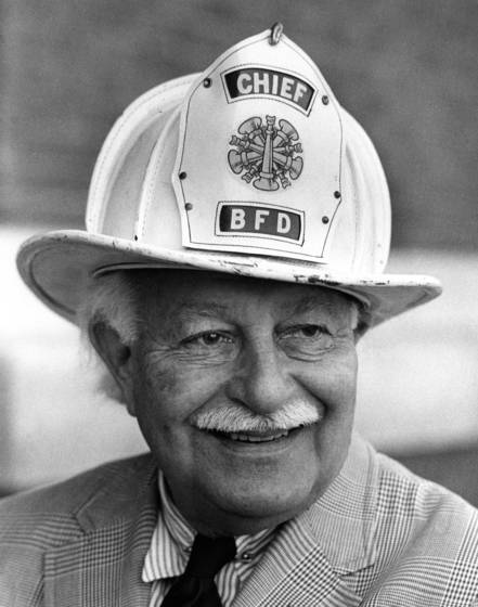 Arthur fielder showing off one of his fire helmuts