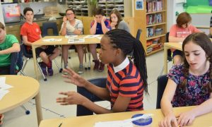 Naila Strong (center) during a discussion on what it means to be white with her seventh grade classmates at the Bank Street School (Richard Yeh/WNYC)
