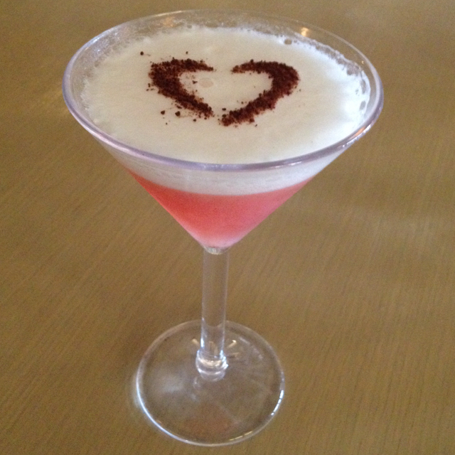 Strawberry Martini toped with chocolate vodka foam and cocoa powder heart