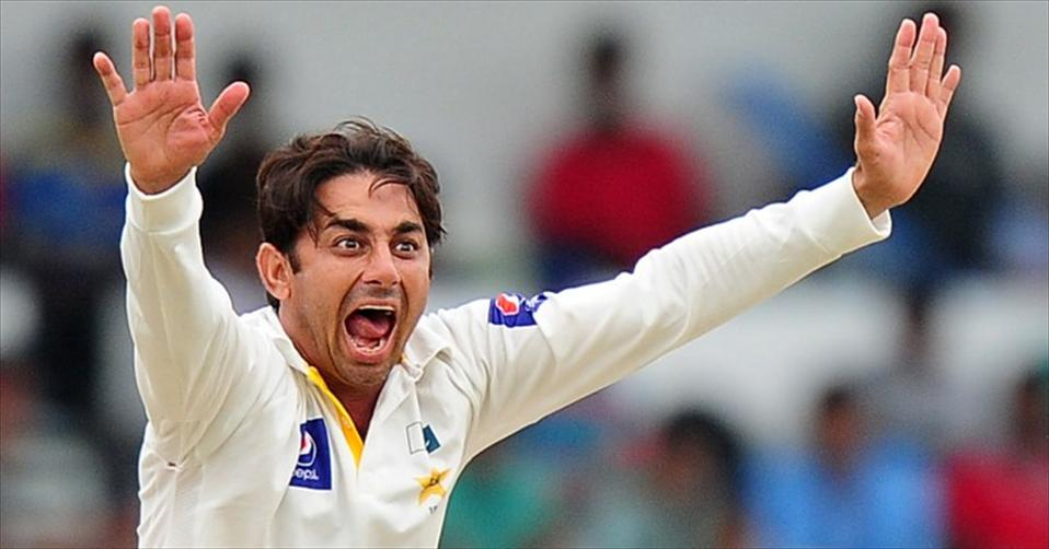 Ajmal banned from bowling after testing