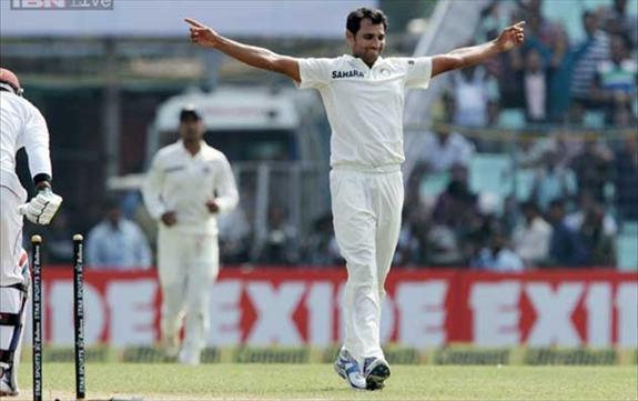 Shami takes 9 and Sharma makes 177 on debut
