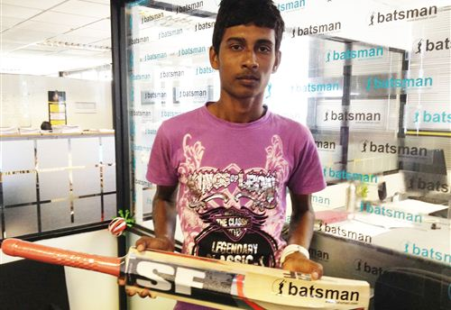 Yohan  De Silva of Dharmasoka gets a cricket bat