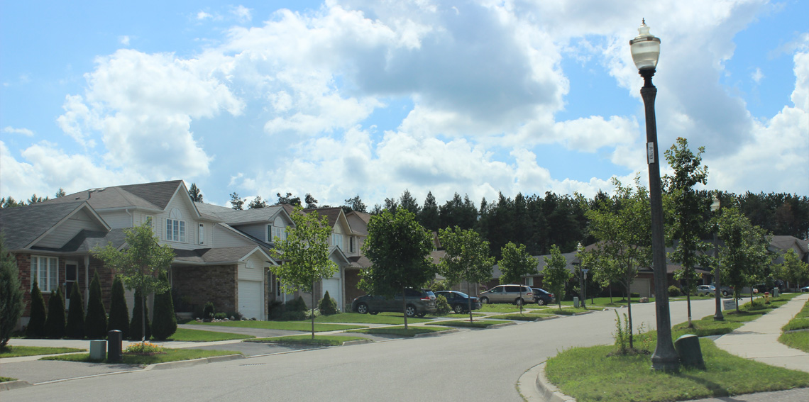 New suburban homes dotting a dense network of streets and cul-de-sacs