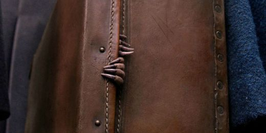 Newt Scamander's suitcase with the claws of a Niffler poking out