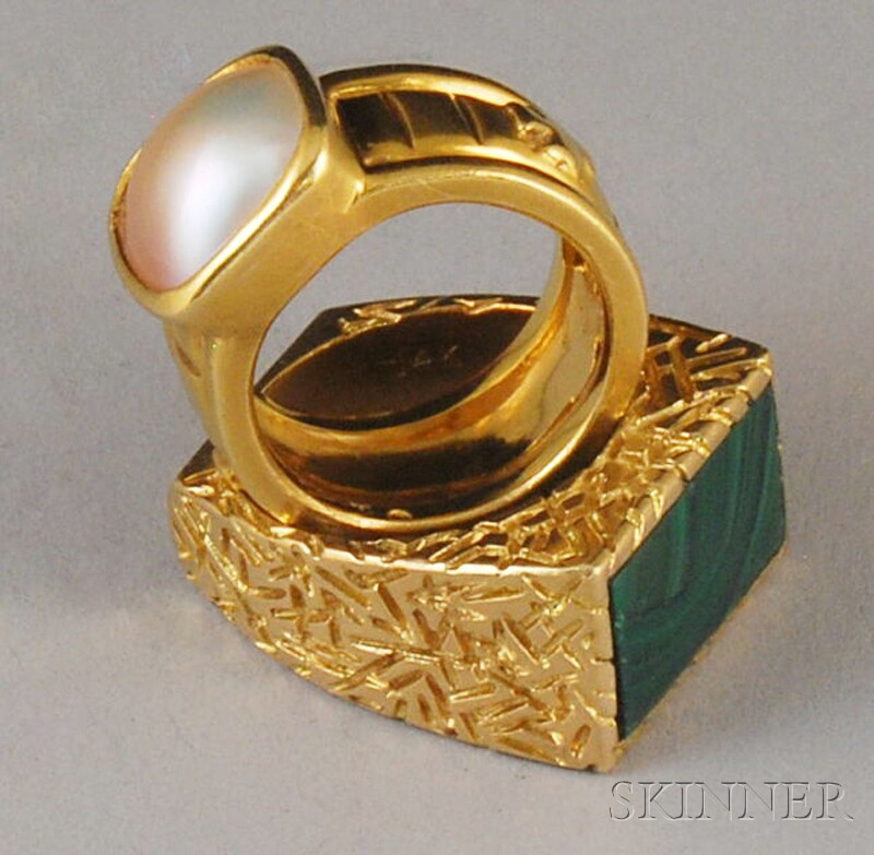 two heavy gold rings bidsquare