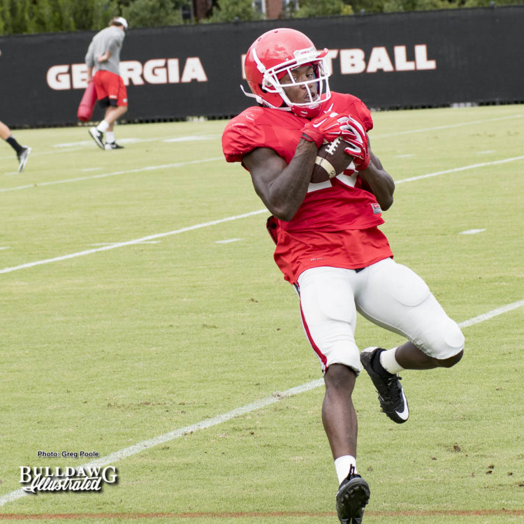 Georgia receiver works on catching wet balls in Tuesday's practice in anticipation of possible rain during Saturday's game.