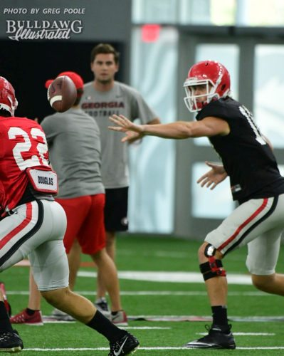 Jacob Eason tosses the ball to No. 22 (not Nate McBride)