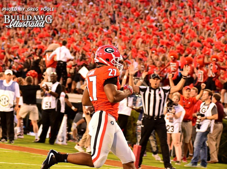 Georgia's Nick Chubb takes the handoff 7-yards into the endzone for a touchdown, putting UGA up 14-0 over Mississippi State in the first quarter.  - Saturday, Sept. 23, 2017 -