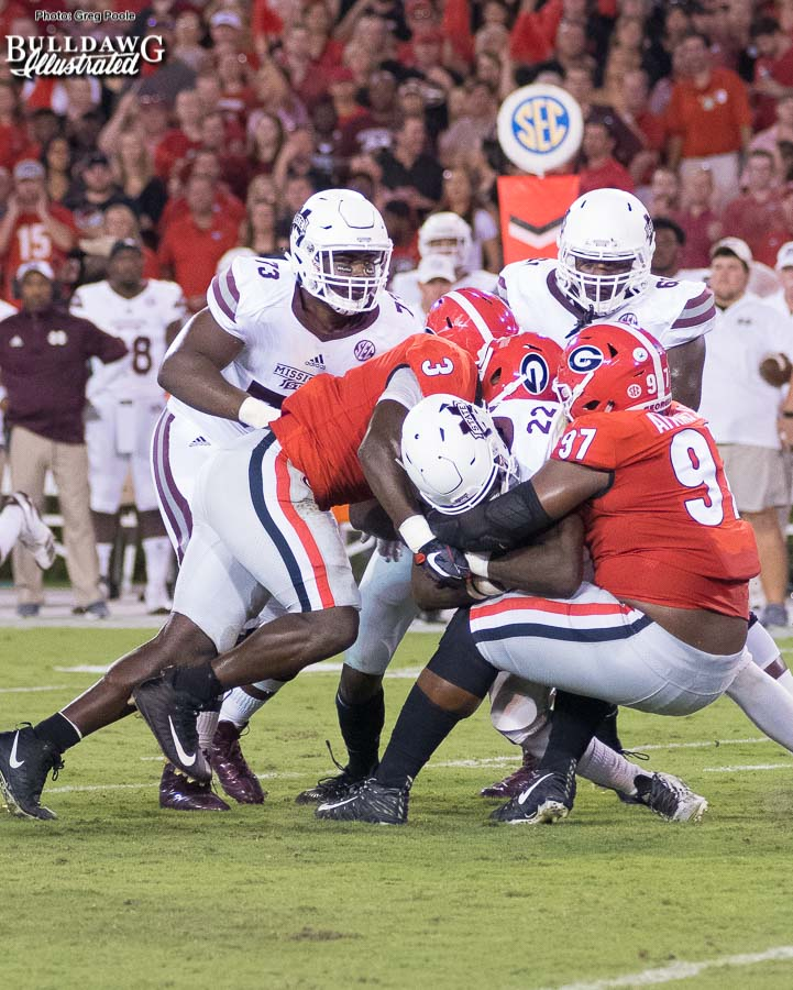 Georgia's John Atkins (97) and Roquan Smith (3) tag team Mississippi State RB Aeris Williams (22) - UGA vs. Mississippi State - Saturday, Sept. 23, 2017