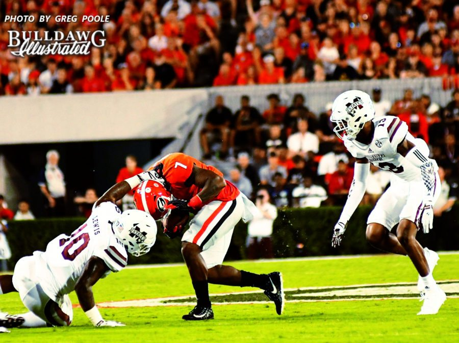 "Georgia runningback D'Andre Swift (7) is ""horse collared"" by Mississippi State linebacker Leo Lewis (10) - UGA vs. Mississippi State -  Saturday, Sept. 23, 2017"