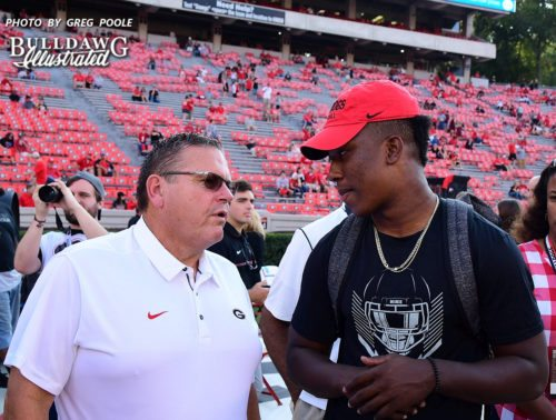 Georgia O-line coach Sam Pittman (left) with 2018 DE prospect KJ Henry (right) - UGA vs. Mississippi State game - Saturday, September 23, 2017