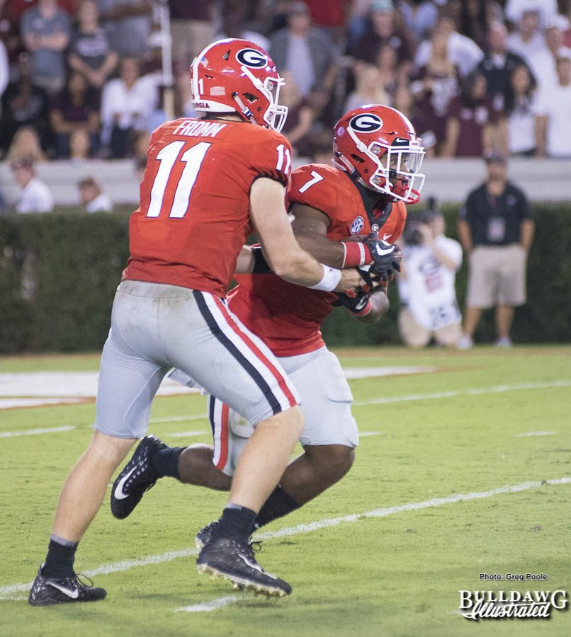 "Jake Fromm (11) hands the ""rock"" off to fellow freshman and tailback D'Andre Swift (7) - UGA vs. Mississippi State - Saturday, Sept. 23, 2017"