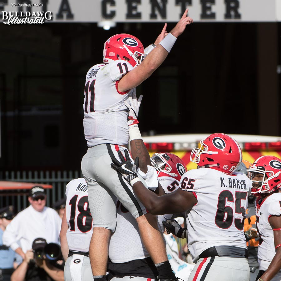 Georgia QB Jake Fromm (11) celebrates with Lamont Gaillard (53) and Kendall Baker (65) after he scores a 9-yard rushing TD - 2nd quarter, UGA vs. Tennessee - Saturday, Sept. 30, 2017