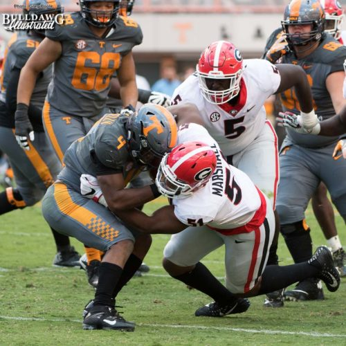 Vol running back John Kelly (4) is stuffed by Bulldog d-lineman David Marshall (51) as Julian Rochester (5) comes in to help clean-up - 3rd quarter, UGA vs. Tennessee - Saturday, Sept. 30, 2017
