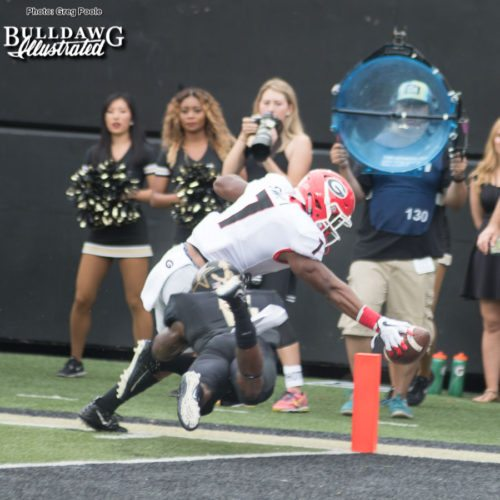 D'Andre Swift (7) stretches for the pylon and goal line. Did the ball cross the plane before he stepped out? - UGA vs. Vanderbilt - Saturday, October 7, 2017
