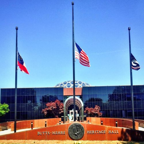 Flags at UGA's Butts-Mehre Heritage Hall fly at half-staff