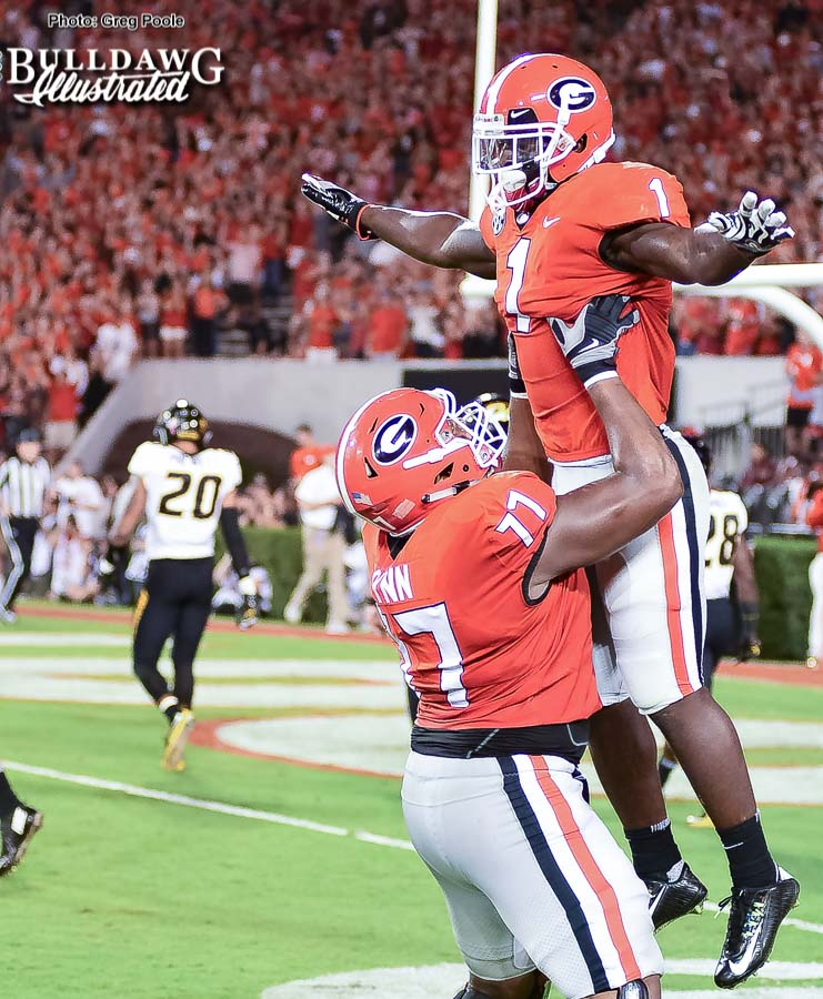 Isaiah Wynn (77) celebrated with Sony Michel (1) after the senior running back breaks off a 35-yard touchdown run in the second quarter to put the Bulldogs back on top 20-14. - UGA vs. Missouri - Saturday, Oct. 14, 2017