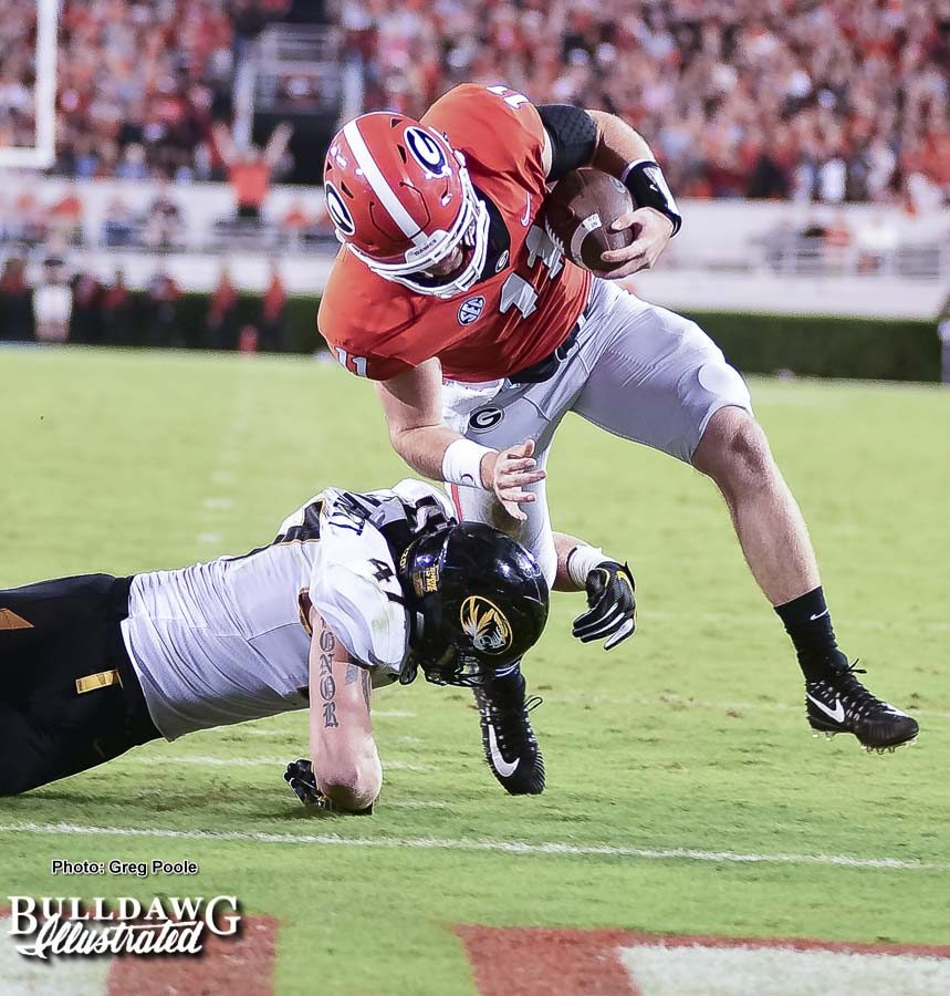 Jake Fromm (11) avoids the tackle to punch it in the end zone during Georgia's homecoming game versus Missouri