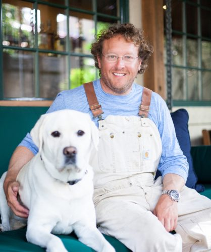 Chef Dave Snyder with his yellow lab Gustavo (Photo by Lilly Jo Photography)