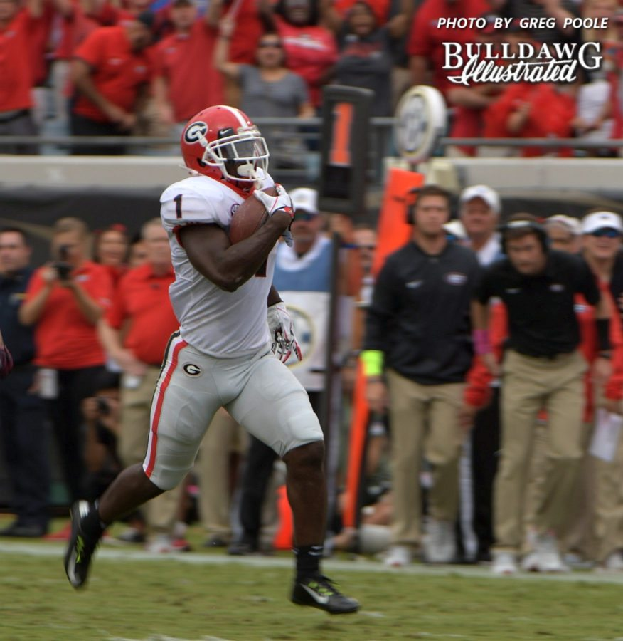 Sony Michel (1) rumbles down the field for a 74-yard touchdown run during the first quarter of the Georgia-Florida game on Saturday, Oct. 28, 2017.