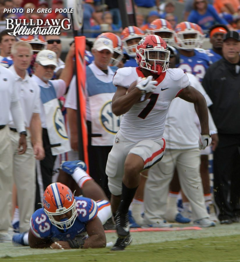 Bulldog freshman tailback D'Andre Swift (7) takes a Jake Fromm pass 39-yards down to the Gator 6-yard line for a 1st down and goal in the first quarter of Saturday's Georgia-Florida game.