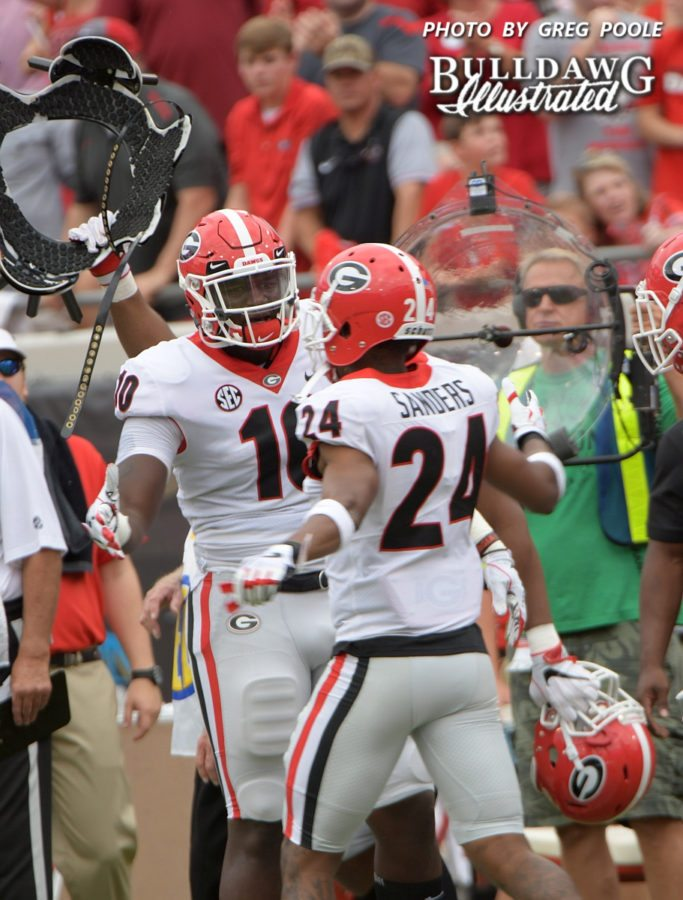 Malik Herring (10) congratulates Dominick Sanders (24) after the senior safety picks off his 15th career intecption. - Georgia-Florida, Saturday, Oct. 28, 2017 -