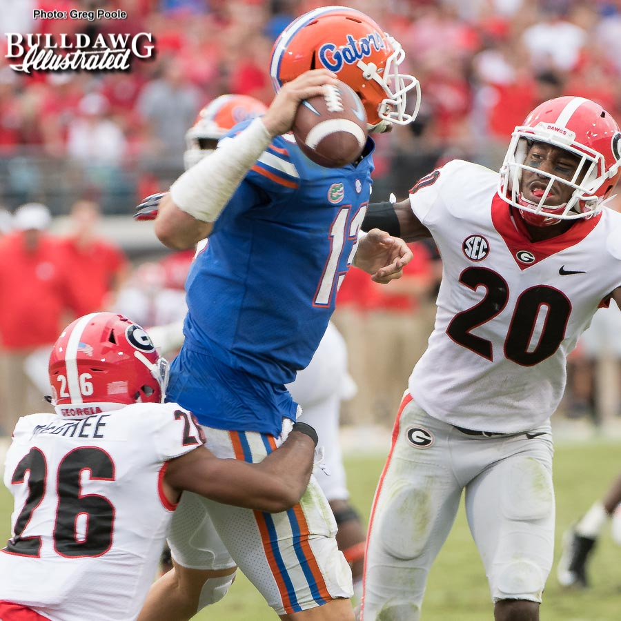 Tyrique McGhee and J.R. Reed sack Florida quarterback Felipe Franks to cause a fumble.
