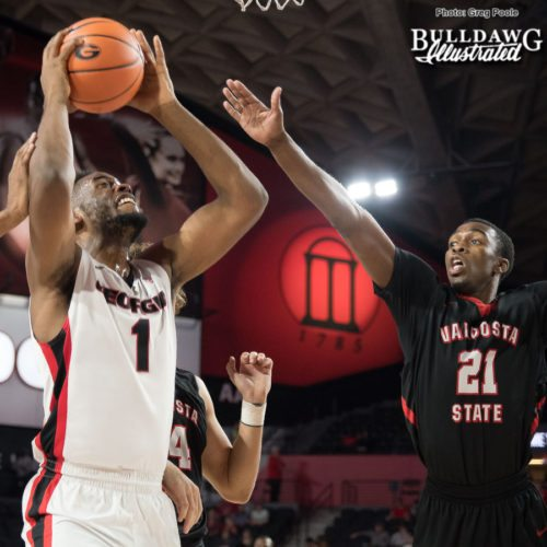 Yante Maten eyes the basket and shoots over the Valdosta State defender.