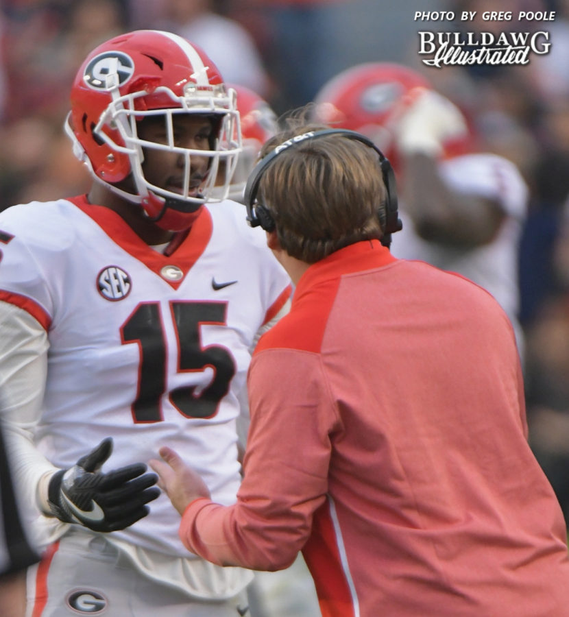 D'Andre Walker (15) pleads his case to Head Coach Kirby Smart after a costly penalty during Georgia's 40-17 loss to Auburn on Saturday, Nov. 11, 2017.