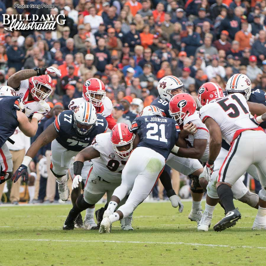 Georgia noseguard John Atkins (97) gets penetration and meets Tiger RB Kerryon Johnson (21) in the backfield. - UGA vs. Auburn, Sat., Nov. 11, 2017 -