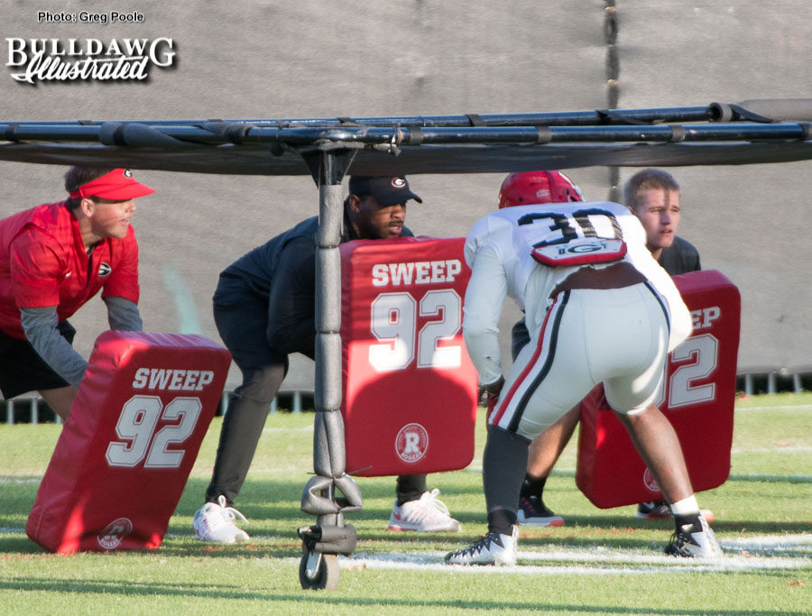 Linebacker Tae Crowder works under the chute during Tuesday's afternoon practice.