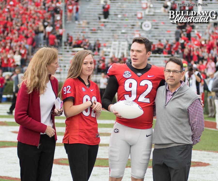Punter Cameron Nizialek with his family being honored on Senior Day at Georgia vs. Kentucky on Saturday, Nov. 18, 2017.