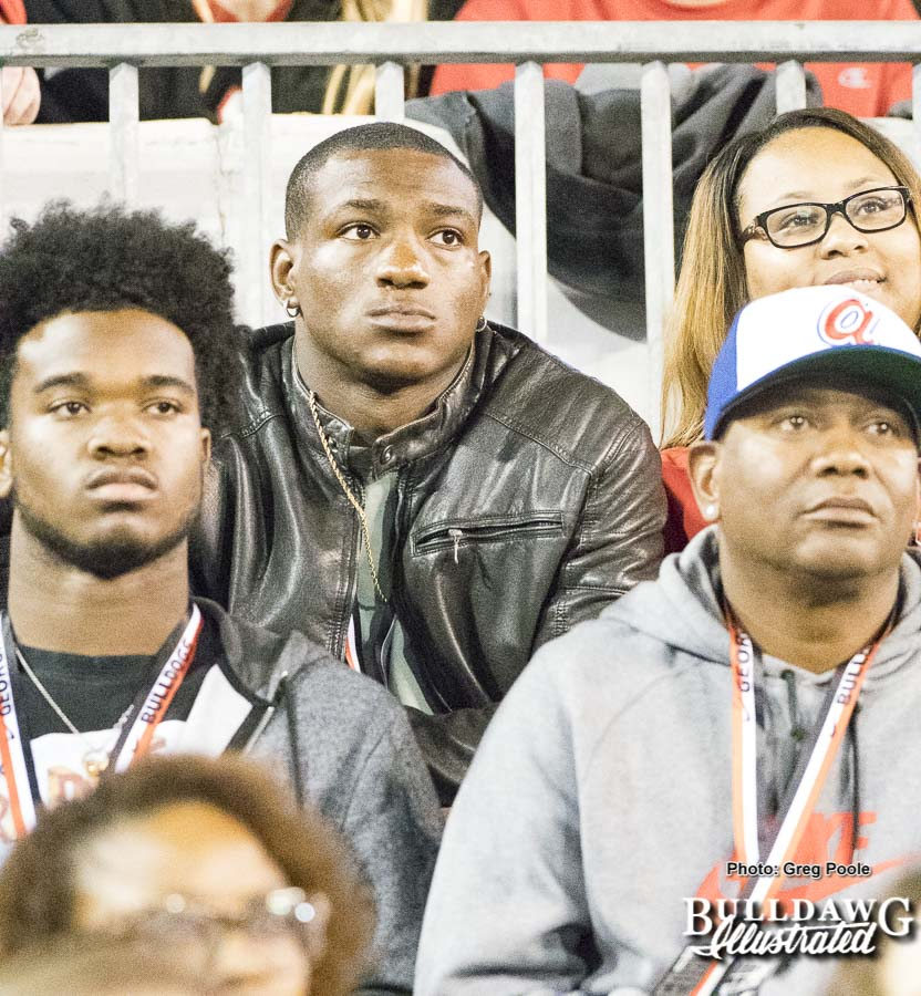 UGA running back committ Zamir White (black jacket) watches intently as Georgia downs Kentucky