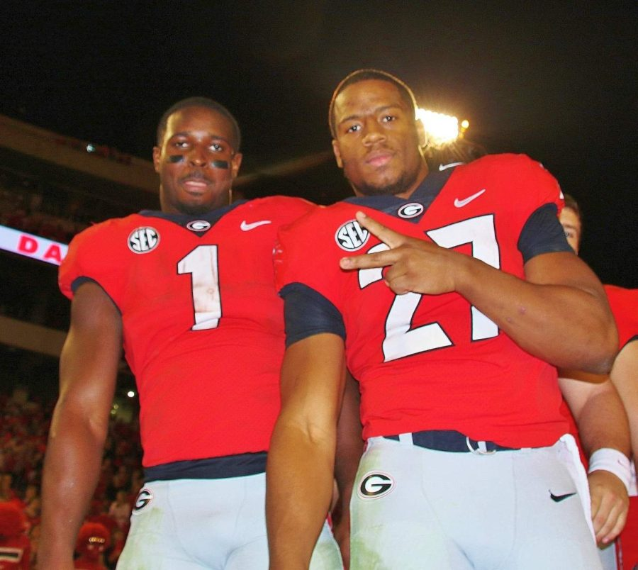 Senior's Sony Michel (1) and Nick Chubb (27) celebrate Georgia's 42-13 win over Kentucky on Saturday evening at Sanford Stadium. (Photo by Rob Saye)