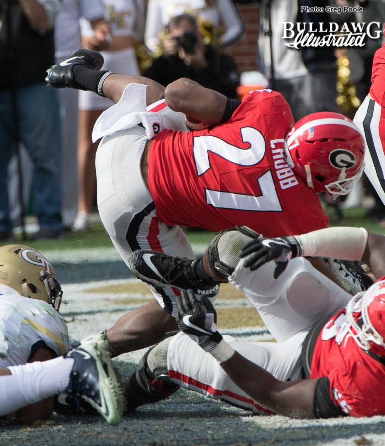 Senior Bulldog tailback Nick Chubb (27) barrels his way in for a touchdown to put Georgia up 6-0 over the Yellow Jackets in the first-quarter. - UGA vs. GT - Saturday, Nov. 25, 2017 -