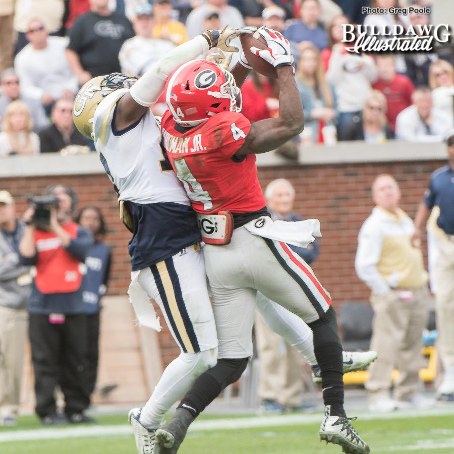 Mecole Hardman (4) makes a spectacular grap falling backwards resulting in a 39-yard pass reception from Jake Fromm in the third quarter. - UGA vs. GT - Saturday, Nov. 25, 2017 -